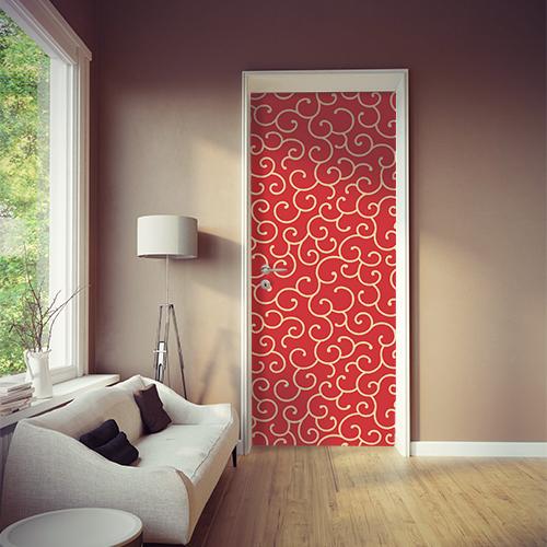 Salle à vivre moderne avec une porte ornée d'un sticker autocollant arabesque rouge