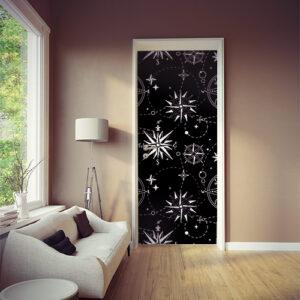 Sticker autocollant décoratif mosaïque de roses des vents blanches sur noir collé sur la porte de la pièce à vivre