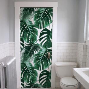 Sticker adhésif décoratif fougère collé sur la porte des WC