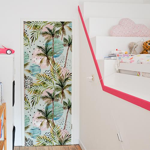 Chambre d'enfant décorée par un adhésif pour porte Ile du Paradis.