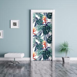 Séjour moderne décoré avec un adhésif déco pour porte et placards exotique motif monstera et fleurs.