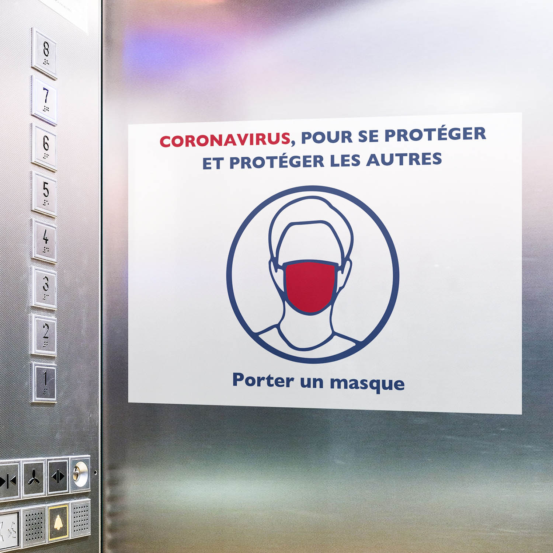 Affiche covid 19 collée dans un ascenseur