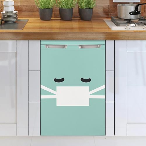 Lave vaisselle blanc orné d'un sticker smiley malade turquoise